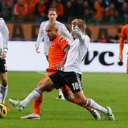 NLD/Amsterdam/20121114 - Vriendschappelijk duel Nederland - Duitsland, Lewis Holtby in duel met Nigel de Jong