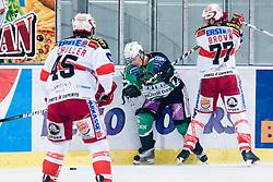 Sean Brown (EC KAC, #77) vs Ales Music (HDD Tilia Olimpija, #16) during ice-hockey match between HDD Tilia Olimpija and EC KAC in 32nd Round of EBEL league, on December 30, 2010 at Hala Tivoli, Ljubljana, Slovenia. (Photo By Matic Klansek Velej / Sportida.com)