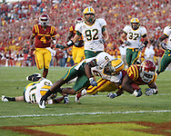 September 3, 2009: Iowa State running back Alexander Robinson (33) dives into the end zone to score the first touchdown of the game on an 18 yard run as he is hit by North Dakota State cornerback Richard Bowman (6) during the first half of the Iowa State Cyclones' 34-17 win over the North Dakota State Bison at Jack Trice Stadium in Ames, Iowa on September 3, 2009.