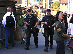 Armed police during the Manchester Arena National Service of Commemoration at Manchester Cathedral to mark one year since the attack on Manchester Arena.