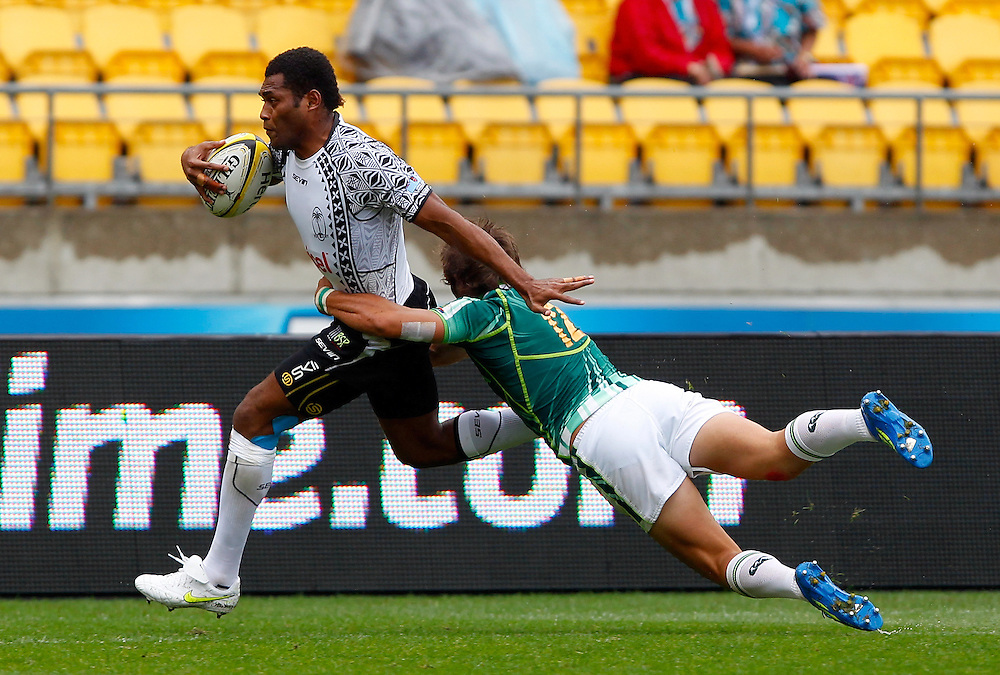 Fiji's Metuisela Talebula attempts to keep Steven Hunt of South Africa at bay as they run down the sideline during day two of  the IRB Sevens Tournament, Wellington, New Zealand, Saturday February 04, 2012. Credit: SNPA / Dean Pemberton