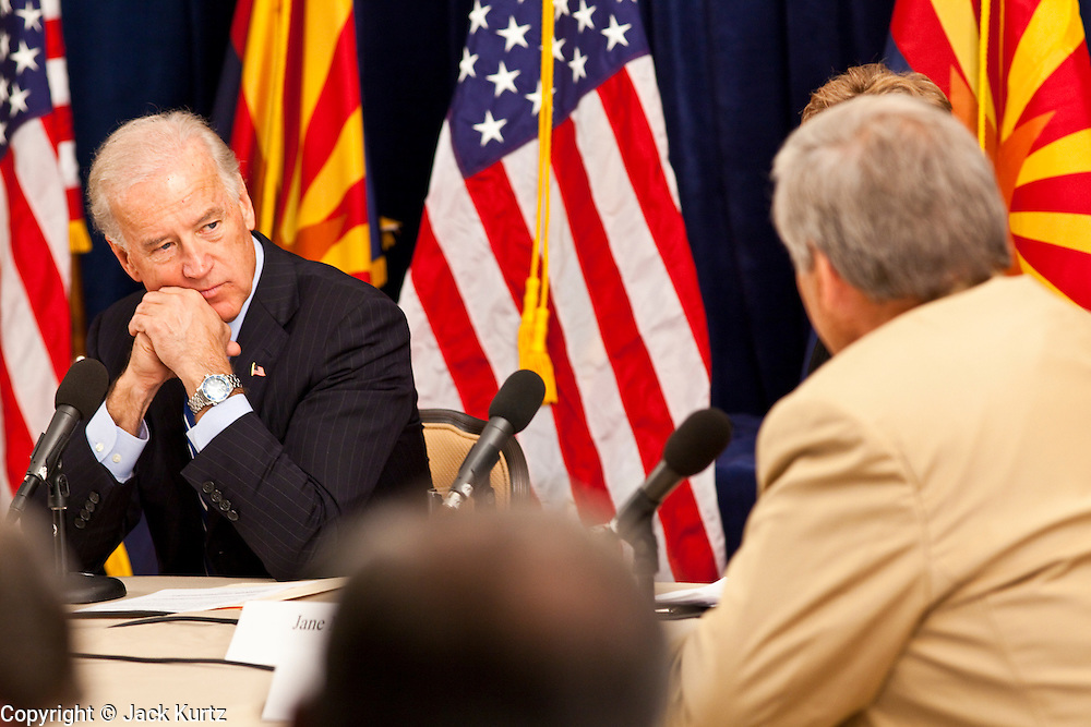 16 NOVEMBER 2009 -- PHOENIX, AZ:  Vice President Joe Biden (CQ) LEFT, listens to Donald Karner (CQ) from Electric Transportation and Engineering (CQ) during a discussion on the economic stimulus. Vice President Joe Biden was at Sky Harbor International Airport Monday morning to participate in a round table discussion the Obama administration's economic stimulus program.     Photo by Jack Kurtz
