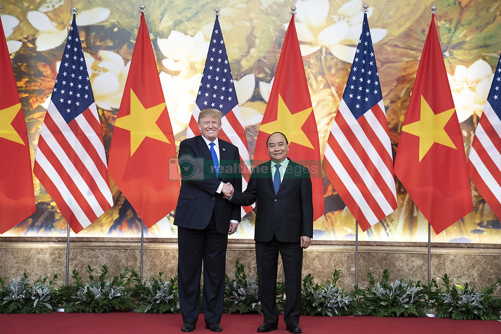 February 27, 2019 - Hanoi, Vietnam - U.S President DONALD TRUMP and Vietnamese Prime Minister NGUYEN XUAN PHUC greet prior to their meeting in the main foyer of the Office of Government Hall in Hanoi, Vietnam. (Credit Image: © Shealah Craighead/The White House via ZUMA Wire)