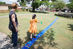 Girl with learning disabilities playing throwing game,