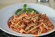 plate of linguine with chicken and tomato sauce