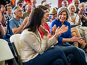 "15 JUNE 2019 - BOONE, IOWA: US Senator JONI ERNST (R-IA), right, Goveror KIM REYNOLDS (R-IA), center, and former UN Ambassador NIKKI HALEY applaud during a speech by US Senator Chuck Grassley at ""Joni's Roast and Ride,"" an annual motorcycle ride / barbecue fund raiser hosted by Ernst. Ernst, Iowa's junior US Senator, kicked off her re-election campaign during the ""Roast and Ride"", an annual fund raiser and campaign event has she held since originally being elected to the US Senate in 2014.    PHOTO BY JACK KURTZ"