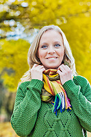 Portrait of Beautiful woman standing and smiling while holding her scarf
