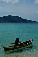 A fisherman from Cayos Cochinos, in Honduras's Bay Islands, paddles his canoe.