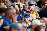 Baby wearing AFC Wimbledon kit in crowd during the EFL Sky Bet League 1 match between AFC Wimbledon and Rotherham United at the Cherry Red Records Stadium, Kingston, England on 3 August 2019.