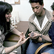 Birth Control Counseling - NYU college campus, couple shown how to use prophylactic.
