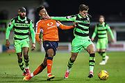 Forest Green Rovers Charlie Cooper(15) holds off Luton Town's James Justin during the EFL Sky Bet League 2 match between Forest Green Rovers and Luton Town at the New Lawn, Forest Green, United Kingdom on 16 December 2017. Photo by Shane Healey.