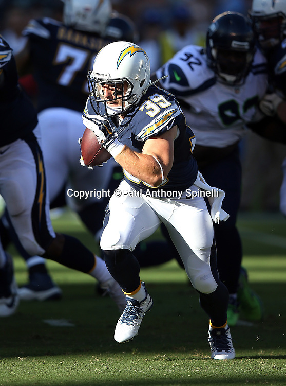 San Diego Chargers running back Danny Woodhead (39) dashes for a first quarter gain of 6 yards as he runs into the late day sunlight creating shadows on the field during the 2015 NFL preseason football game against the Seattle Seahawks on Saturday, Aug. 29, 2015 in San Diego. The Seahawks won the game 16-15. (©Paul Anthony Spinelli)