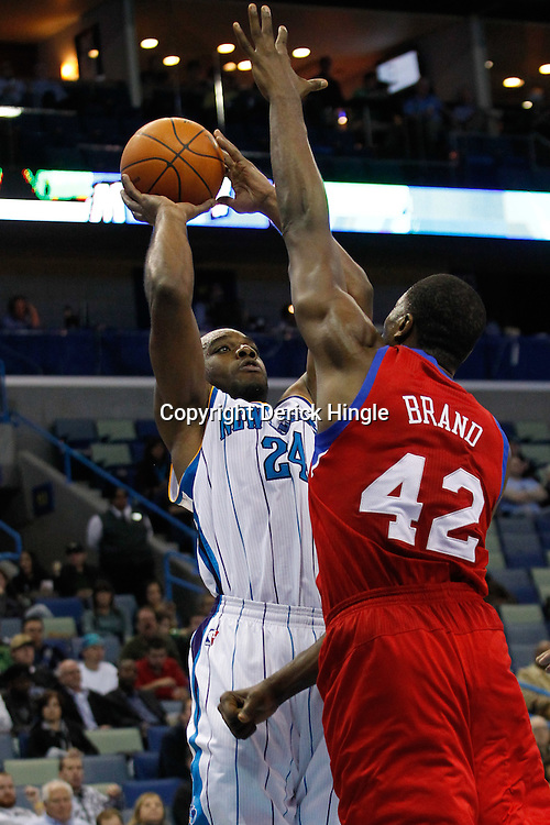January 4, 2012; New Orleans, LA, USA; New Orleans Hornets power forward Carl Landry (24) shoots over Philadelphia 76ers power forward Elton Brand (42) during the second quarter of a game at the New Orleans Arena.   Mandatory Credit: Derick E. Hingle-US PRESSWIRE