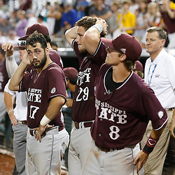 Jun 25, 2013; Omaha, NE, USA; Mississippi State Bulldogs catcher Nick Ammirati (17), catcher Mitch Slauter (29), and third baseman Sam Frost (8) react after game 2 of the College World Series finals against the UCLA Bruins at TD Ameritrade Park. UCLA defeated Mississippi State 8-0. Mandatory Credit: Derick E. Hingle-USA TODAY Sports