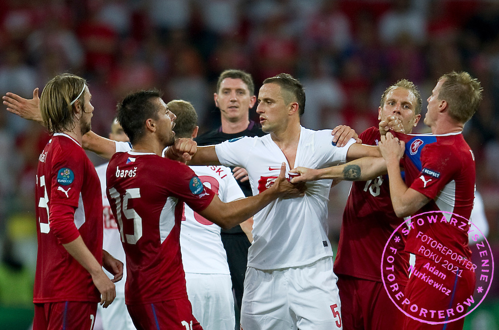 (C) Poland's Dariusz Dudka (nr05) fight with (L) Czech's Milan Baros (nr15) & (R) Czech's David Limbersky (nr08) during the UEFA EURO 2012 Group A football match between Poland and Czech Republic at Municipal Stadium in Wroclaw on June 16, 2012...Poland, Wroclaw, June 16, 2012..Picture also available in RAW (NEF) or TIFF format on special request...For editorial use only. Any commercial or promotional use requires permission...Photo by © Adam Nurkiewicz / Mediasport