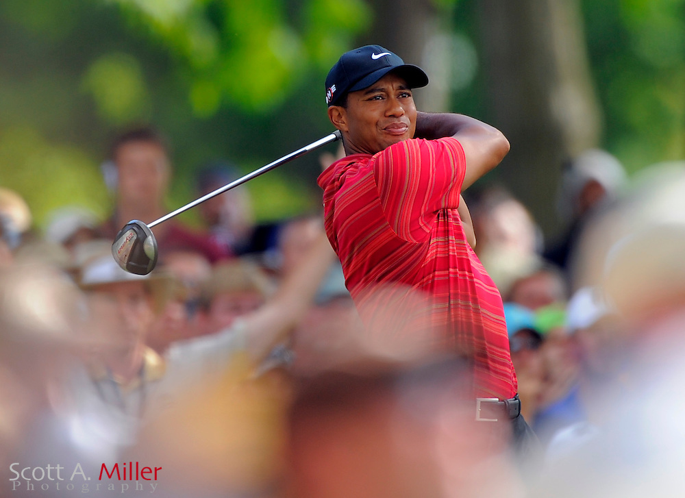 Aug 16, 2009; Chaska, MN, USA; Tiger Woods (USA) hits his tee shot on the 15th hole during the final round of the 2009 PGA Championship at Hazeltine National Golf Club.  ©2009 Scott A. Miller
