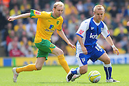 London - Saturday, April 17th 2010: Stephen Hughes of Norwich City and Danny Jackman of Gillingham during the Coca Cola League One match at Carrow Road, Norwich..(Pic by Alex Broadway/Focus Images)