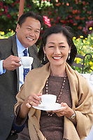 Smiling Couple With a Cup of Tea