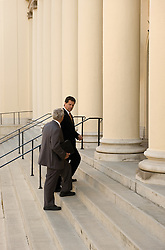 Attorney and client walking up the steps of a courthouse