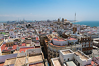 The view of the city of Cadiz from Torre Tavira looks over the rooftops to the Atlantic Ocean and features a multitude of tower styles and ancient architecture.
