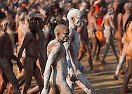 Naga Sadhu from Juna Akhara going to bath. Maha Kumbh Mela festival, world's largest congregation of religious pilgrims. Allahabad, India.
