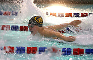 Kennedy's Michele Wasta looks over to the next lane as she swims in the 100 yard butterfly during the Kennedy at Washington meet at Washington High School in Cedar Rapids on Tuesday evening, October 2, 2012. Wasta won the event with a time of 1:07.60.