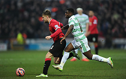 Manchester United's Luke Shaw battles for the ball with Yeovil Town's Nana Ofori-Twumasi  - Photo mandatory by-line: Joe meredith/JMP - Mobile: 07966 386802 - 04/01/2015 - SPORT - football - Yeovil - Huish Park - Yeovil Town v Manchester United - FA Cup - Third Round
