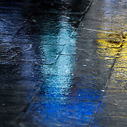 June 8, 2016 - New York, NY : Colorful umbrellas are reflected in the slick stonework during a downpour outside 500 Pearl Street in lower Manhattan on Wednesday afternoon. CREDIT: Karsten Moran for The New York Times