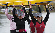 "October 24, 2010 - Boston, MA - Arlington-Belmont varsity crew members, Devynn Diggins, AHS '13, Sarah Franz , AHS '11, Jill Carney, BHS '13, and Helena Awad, AHS '13, take their boat out of the water. It was the team's first regatta. ""The team finished in 64th place, but I'll take it,"" said Varsity Girls Coach, Nicholas Wright. (Photo/Matt Wright 2010)"