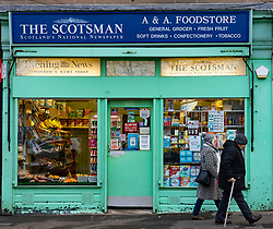 Exterior of traditional newsagent shop selling The Scotsman newspaper on Easter Road in Edinburgh, Scotland, UK