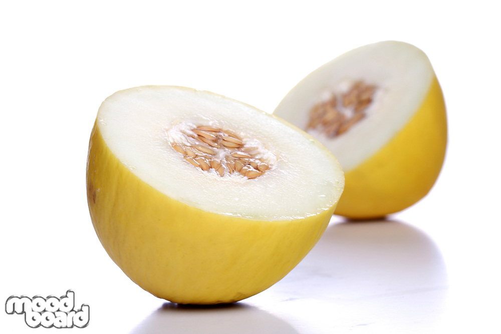 Halved melon on white background close up