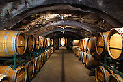 Oak barrels for aging wine in the wine cave at Storybook Mountian Vineyards.