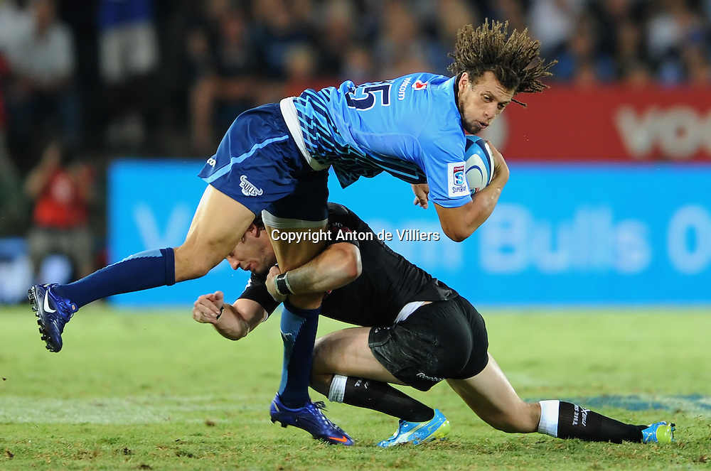 PRETORIA, South Africa, 24 February 2012. Zane Kirchner of the Bulls is tackled by Tim Whitehead of the Sharks during the Super15 Rugby match between the Bulls and the Sharks at Loftus Versfeld in Pretoria, South Africa on 24 February 2012. The Bulls won their first home game 18-13 against the Sharks.<br /> Photographer : Anton de Villiers / SASPA