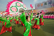 The annual Lotus Lantern Festival is held to celebrate Buddha's Birthday. Opening ceremony for the parade at Dongdaemun Stadium. Traditional fan dancers.