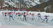 2/26/06 -- The 2006 Torino Winter Olympics -- Pragelato , Italy. -- Cross-Country Men's 50 KM -- .Giorgio di Centa of Italy, right, races toward his first place finish in the 50km mass start cross country race in Pragelato Plan, Italy.