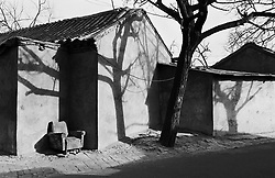 Shadows falling on old houses in a hutong in Beijing