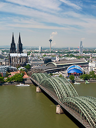 Skyline of city of Cologne with the Cathedral or Dom and Hohenzollern Bridge across the River Rhine in Germany