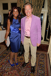 MICHAEL PORTILLO and PHOEBE HITCHCOX at a party to celebrate the publication of Right or Wrong: The Memoirs of Lord Bell held at Mark's Club, Charles Street, London on 16th October 2014.