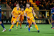 Craig Halkett (#26) of Livingston FC wheels away to celebrate scoring a penalty during the Ladbrokes Scottish Premiership match between Livingston FC and Heart of Midlothian FC at the Tony Macaroni Arena, Livingston, Scotland on 14 December 2018.