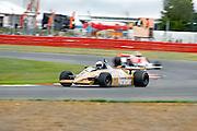 Car No 29 heads around Luffield. Silverstone Classic - 66-85 F1- 25/7/10.