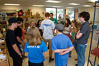"Sandor Ganache leads his freshman advisory group in ""The Big Wind Blows"" activity for students to learn about one another during Freshman Jump Start at GHS Wednesday morning.  (Karen Bobotas/for the Laconia Daily Sun)"
