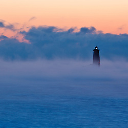 Whaleback Light in the pre-dawn fog. New Castle, New Hampshire.