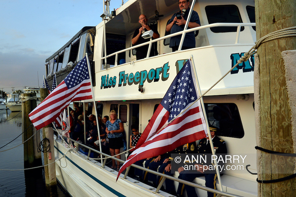 Freeport, New York, USA. 10th Sept. 2014. After a dockside remembrance ceremony in honor of victims of the terrorist attacks of September 11 2001, on Freeport's Nautical Mile, further ceremonies were held on board the boat Miss Freeport V, which sailed from the Woodcleft Canal on the South Shore of Long Island, on the eve of the 13th Anniversary of the 9/11 attacks.