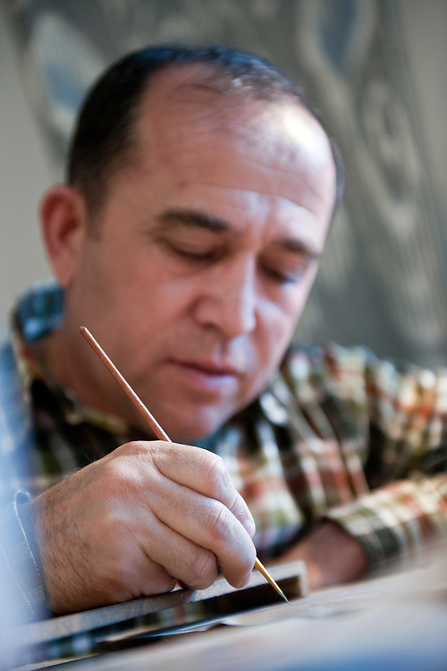 Bukhara, Uzbekistan 24 March 2012. Bukharian artist Davron Toshev paints a miniature in his atelier. Bukhara of the 16th century attracted skilled craftsman of calligraphy and miniature-paintings making of this region the hub of arts.