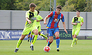 Jake Gray looks to break forward during the U21 Professional Development League match between Crystal Palace U21s and Huddersfield U21s at Imperial Fields, Tooting, United Kingdom on 7 September 2015. Photo by Michael Hulf.