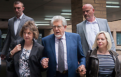 London, May 22nd 2014. Entertainer Rolf Harris leaves Southwark Crown Court with his niece Jenny, left, and his daughter Bindi after testimony from the final prosecution witnesses in his trial on 12 counts of indecent assault against four girls aged between 7 and 19.