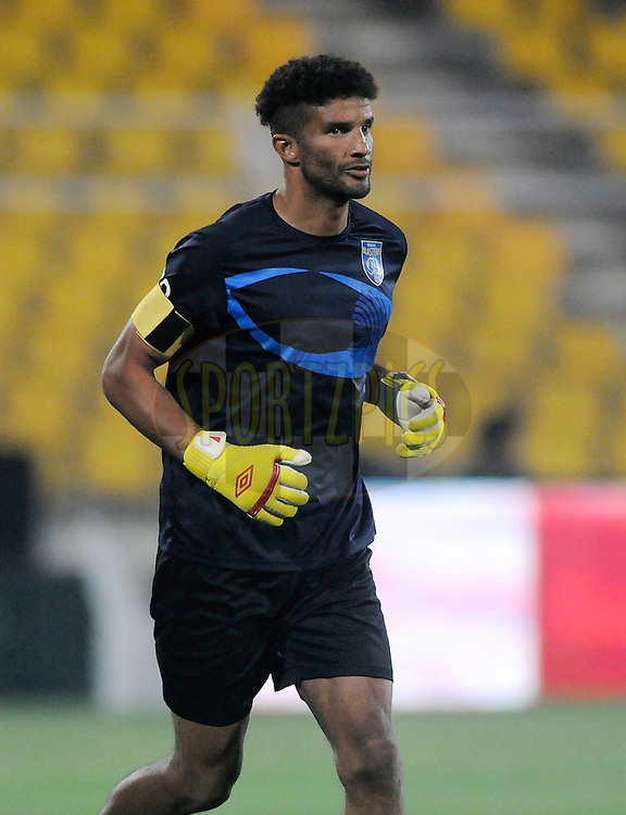 David James of Kerala Blasters FC runs for a warm up session after receiving the Golden gloves arm band before the start of match 41 of the Hero Indian Super League between FC Goa and Kerala Blasters FC held at the Jawaharlal Nehru Stadium, Fatorda, India on the 26th November 2014.<br /> <br /> Photo by:  Pal Pillai/ ISL/ SPORTZPICS