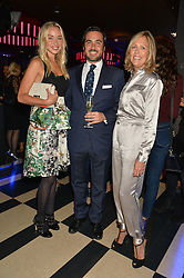 Left to right, NOELLE RENO, EDUARDO SANCHEZ and JULIET HERD at a party to celebrate the 1st anniversary of Hello! Fashion Monthly magazine held at Charlie, 15 Berkeley Street, London on 14th October 2015.