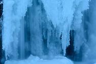 Close-up of icicles of the waterfall Kirkjufellsfoss at dusk in the winter, village Grundarfjoerdur, Peninsula Snaefellsnes, Iceland