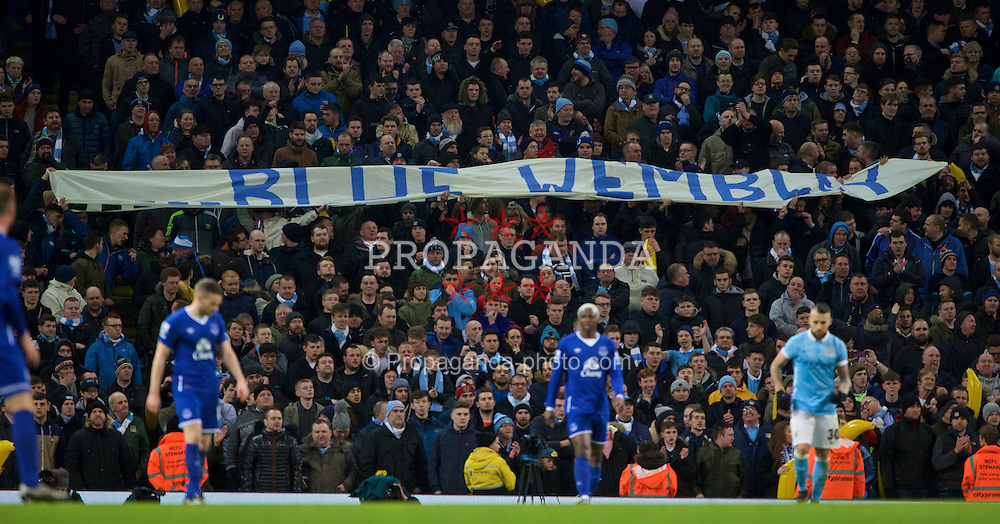 """MANCHESTER, ENGLAND - Wednesday, January 27, 2016: Manchester City supporters with a """"Blue Wembley"""" banner during the Football League Cup Semi-Final 2nd Leg match against Everton at the City of Manchester Stadium. (Pic by David Rawcliffe/Propaganda)"""